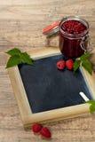 Raspberries jam. Fresh Raspberries jam with chalkboard. Selective focus Stock Photo