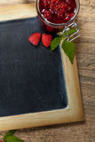 Raspberries jam. Fresh Raspberries jam with chalkboard. Selective focus Stock Images