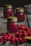 Raspberries jam on the table Stock Images