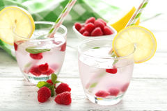 Raspberries and juice. In glass on white wooden background Royalty Free Stock Photo