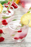 Raspberries and juice. In glass on white wooden background Royalty Free Stock Images