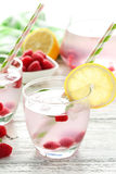 Raspberries and juice. In glass on white wooden background Stock Images