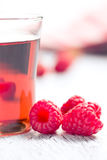 Raspberries and juice. On old wooden table Stock Photo