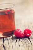 Raspberries and juice. On old wooden table Royalty Free Stock Photo