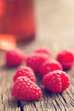 Raspberries and juice. On old wooden table Royalty Free Stock Image