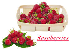 Raspberries with leaves and basket of raspberries Stock Images