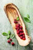 Raspberries with leaves Royalty Free Stock Photo