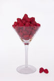 Raspberries in a martini glass Stock Photography