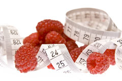 Raspberries with measuring tape Stock Image