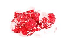 Raspberries in milk, cream squirts. On white background Royalty Free Stock Image