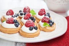 Raspberries mini cakes Stock Photo