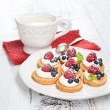 Raspberries mini cakes Stock Photos