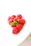 Raspberries with mint Royalty Free Stock Images