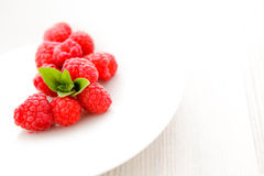 Raspberries with mint Stock Image