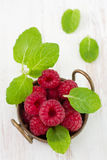 Raspberries with mint Stock Images