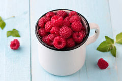 Raspberries in a mug Royalty Free Stock Photography