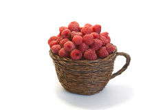 Raspberries in a mug  on white Royalty Free Stock Images