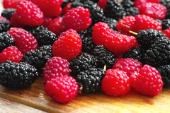 Raspberries and mulberries Royalty Free Stock Photo