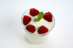 Raspberries in natural yoghurt Stock Photography