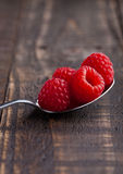 Raspberries on old spoon on grunge wooden board. Natural healthy food. Still life photography Royalty Free Stock Photography