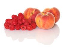 Raspberries And Peaches Stock Photos