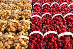 Raspberries and physalis. In baskets, ready to be sell at the market Stock Image