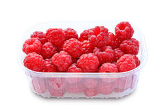 Raspberries in plastic box isolated on white background Royalty Free Stock Photo