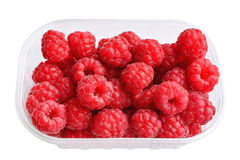 Raspberries in plastic box on white Royalty Free Stock Photo