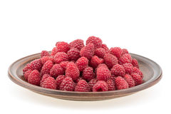 Raspberries in plate isolated on white background cutout. Selective focus Royalty Free Stock Photo