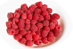 Raspberries on a plate over white Stock Image