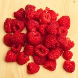 Raspberries on a plate. Sweet and red raspberries on a plate Royalty Free Stock Photography