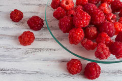 Raspberries. On a plate with a white wooden background Stock Images