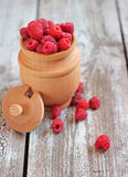 Raspberries in a pot on the table, selective focus. Fresh raspberries in a wooden pot on the table, selective focus Royalty Free Stock Photography