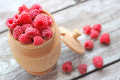 Raspberries in a pot on the table, selective focus. Fresh raspberries in a wooden pot on the table, selective focus Stock Photography
