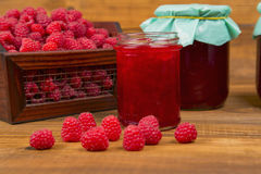 Raspberries and raspberry jam. On a wooden table Stock Photography