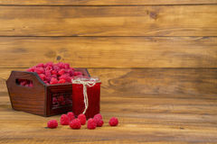 Raspberries and raspberry jam. On a wooden table Stock Images