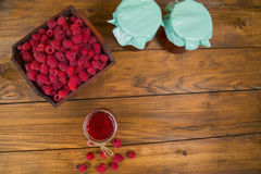 Raspberries and raspberry jam. On a wooden table Royalty Free Stock Image