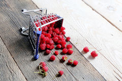 Raspberries in a shopping cart Royalty Free Stock Images