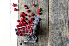 Raspberries in a shopping cart Royalty Free Stock Photography