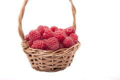 Raspberries in a small basket Stock Photos