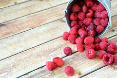 Raspberries in a small bucket. On a boards Royalty Free Stock Photo