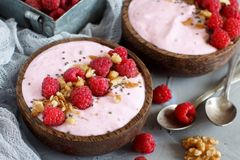 Raspberries smoothie bowls. Topped with fresh raspberries Royalty Free Stock Photo