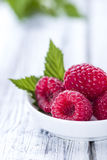 Raspberries. Some fresh harvested raspberries (close-up shot Royalty Free Stock Photography