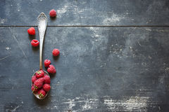 Raspberries in spoon Stock Image