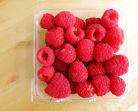 Raspberries still life on wood table Stock Images