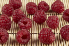 Raspberries on a straw mat Royalty Free Stock Image