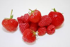 Raspberries and strawberries Royalty Free Stock Images