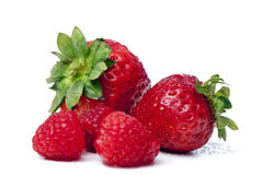 Raspberries, strawberries Stock Images