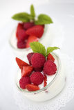 Raspberries and Strawberries royalty free stock image