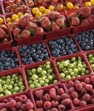 Raspberries, strawberries Stock Photos